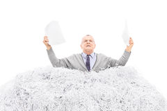 Desperate senior holding a torn file Stock Photography