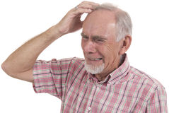 Desperate senior man. Very distressed senior man with expression of agony or torment Royalty Free Stock Photography