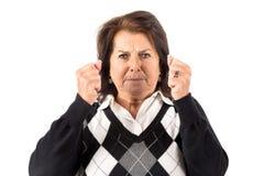 Desperate senior woman Stock Photo