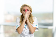 Desperate and shocked young nurse. Stock Images