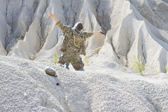 Desperate soldier in the desert Stock Photography