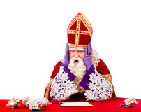Desperate St.Nicholas. Desperate sinterklaas not knowing what to do . typical Dutch character part of a traditional event celebrating the birthday of Sinterklaas Royalty Free Stock Photos