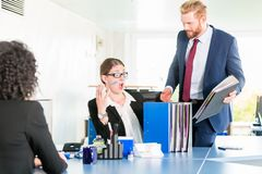 Desperate and stressed assistant at the office Stock Image