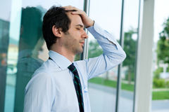 Desperate and stressed businessman feeling bad Stock Photography