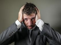 Desperate and stressed businessman holding his head frustrated and worried crying suffering depression problem and anxiety crisis royalty free stock image