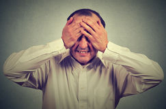 Desperate stressed middle aged man Royalty Free Stock Photo