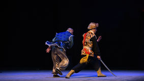 "A desperate struggle-Peking Opera ""Taking Tiger Montain By Strategy"" Royalty Free Stock Image"