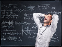 Desperate teacher. And blackboard background Royalty Free Stock Photo