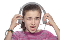 Desperate teenage girl takes off her headphones Stock Photos