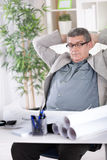 Desperate tired senior businessman in crisis working  at office Royalty Free Stock Image