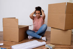 Desperate and tired woman during home relocation. Floor Stock Photography