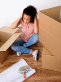 Desperate and tired woman during relocation Stock Photo