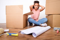 Desperate and tired woman during relocation stock photos