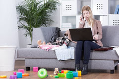 Desperate trials to combine work with motherhood Stock Photography