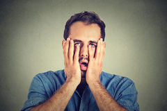 Desperate unhappy man  on gray wall background Royalty Free Stock Photography