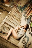 Desperate woman. Young desperate woman in urban deteriorated place Royalty Free Stock Photo
