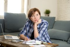 Desperate woman banking and accounting home monthly and credit card expenses with computer laptop doing paperwork Royalty Free Stock Images