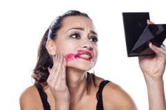 Desperate woman. Desperate beautiful girl removing her makeup with her hand Royalty Free Stock Images