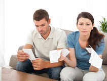 Desperate woman doing her accounts with boyfriend Royalty Free Stock Images