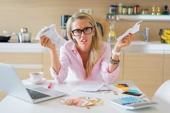 Desperate woman with too many bills to pay Stock Photos
