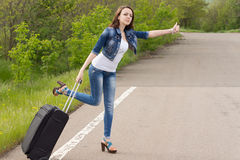 Desperate woman trying to thumb a lift royalty free stock photography