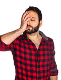 Desperate worker with plaid shirt Stock Photography