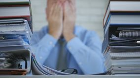 Desperate and Worried Manager Keeping His Head In Hands In Blurred Image stock photography