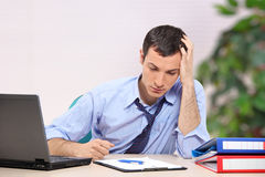 A desperate young businessman in the office Stock Photos