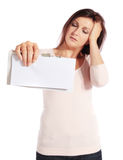 Desperate young woman holding a letter Stock Photography