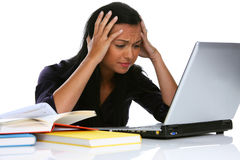 Desperate young woman with a laptop computer. Annoyed Stock Images