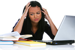 Desperate young woman with a laptop computer. Annoyed Royalty Free Stock Images