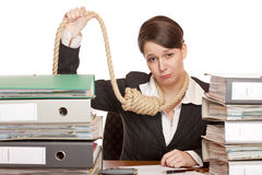 Desperated woman in office with sling around head Stock Photo