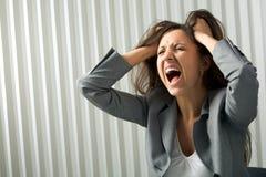 Desperation. Photo of depressed female screaming in desperation Stock Image