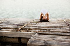 Desperation. Young desperate woman over wooden surface Stock Photography