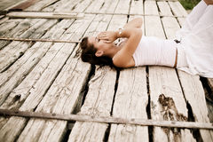 Desperation. Young desperate woman over wooden surface Royalty Free Stock Image