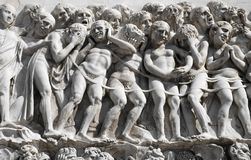 Desperation. Medieval high relief representing a crowd of desperate people Stock Image