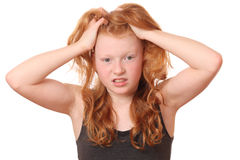 Desperation. Portrait of a desperate young girl on white background Royalty Free Stock Photo