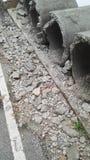 Desperdício da construção ao lado da estrada Imagem de Stock Royalty Free