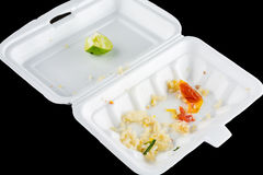 Desperdício de alimento na caixa da espuma imagem de stock