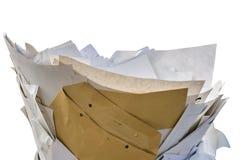 Desperdício de papel na frente do fundo branco fotografia de stock royalty free