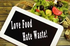 Desperdício do ódio do alimento do amor imagens de stock royalty free