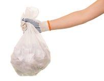Desperdício dos sacos de lixo à disposição no fundo branco imagens de stock royalty free