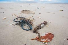 Desperdício na praia Fotografia de Stock