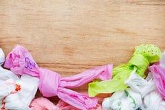 Desperdício plástico, sacos de plástico em de madeira fotos de stock royalty free
