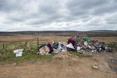 Desperdícios despejados no charneca Foto de Stock Royalty Free