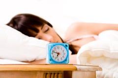 Despertador aproximadamente para acordá-la acima fotografia de stock royalty free