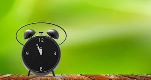 Despertador com minutos pequenos ao pulso de disparo do ` de doze o Foto de Stock Royalty Free