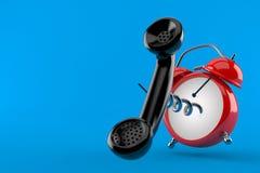 Despertador con el microteléfono Foto de archivo libre de regalías