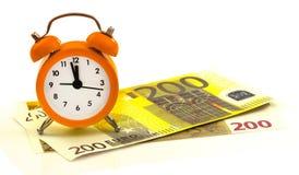 Despertador con los billetes, euro 200 Foto de archivo libre de regalías