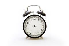 Despertador en estilo retro en el fondo blanco Foto de archivo libre de regalías